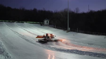 snowcat : Preparation of the track for tubing. Stock Footage