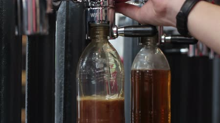 craft beer : filling a plastic bottle of craft beer
