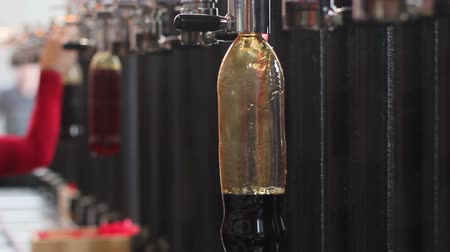 bira fabrikası : craft beer store. filling a plastic bottle