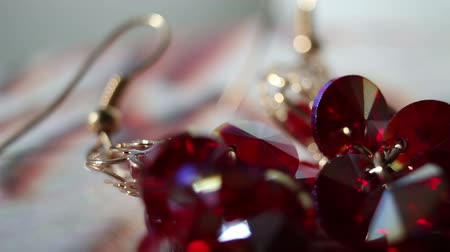 semi precious : earrings with big red stones on spinning stand