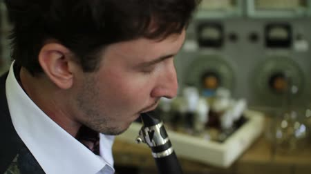 flutist : musician composes a melody for flute