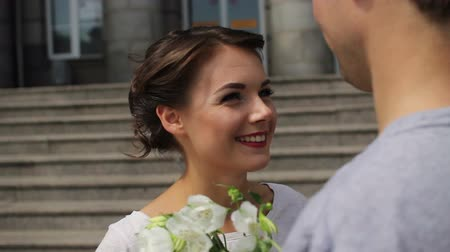 düşünceli : young pretty women with a bouquet smiling to her man after meeting