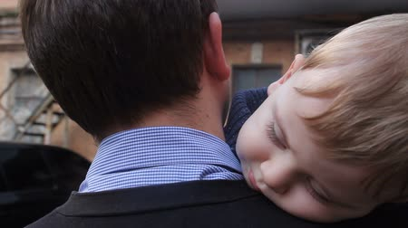 близость : Little boy sleeping on dads shoulder