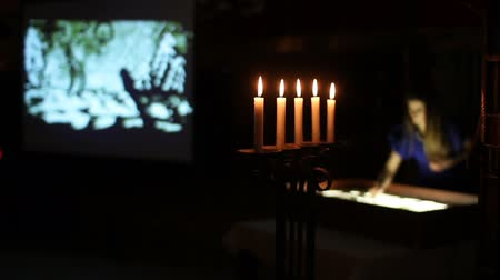 alegorie : Candelstick with candles near the sand animation