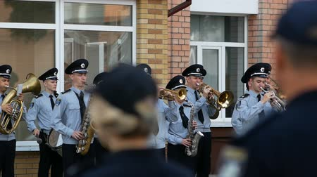 jazz festival : DNIPRO, UKRAINE- AUGUST 7, 2018: Musician military band of the Ukrainian national police plays the trumpet on the march on parade for national championship of canine national polices on August 7, 2018 in Dnipro, Ukraine