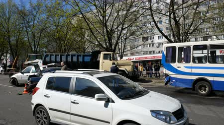 elpusztított : DNIPRO, UKRAINE-April 10, 2019: Broken cars at avenue after road accident with truck, April 10, 2019 in Dnipro, Ukraine Stock mozgókép