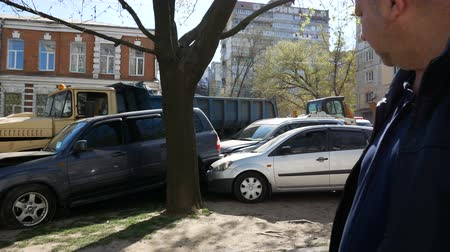 ohnutý : DNIPRO, UKRAINE-April 10, 2019: Broken cars at alley after road accident with truck, April 10, 2019 in Dnipro, Ukraine