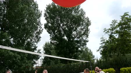 beach volleyball : DNIPRO, UKRAINE-May 10, 2019: Beach Volleyball with huge ball. Game ball under sunlight and blue sky, May 10, 2019 in Dnipro, Ukraine Stock Footage