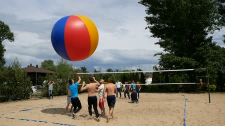 volleyball : DNIPRO, UKRAINE-May 10, 2019: Beach Volleyball with huge ball. Game ball under sunlight and blue sky, May 10, 2019 in Dnipro, Ukraine Stock Footage