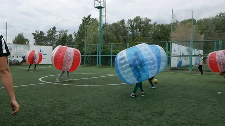 DNIPRO, UKRAINE-May 10, 2019: People play bumperball zorbsoccer outdoor. summer time, May 10, 2019 in Dnipro, Ukraine Stok Video