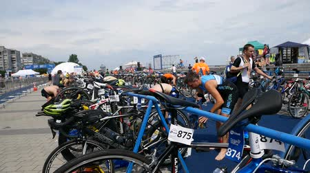 cyclists : DNIPRO, UKRAINE-June 9, 2019: Dnipro Triathlon Festival, athletes are preparing for competition, June 9, 2019 in Dnipro, Ukraine