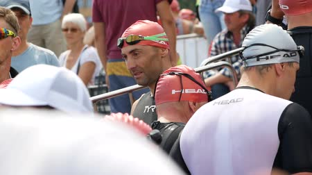 DNIPRO, UKRAINE-June 9, 2019: Dnipro Triathlon Festival, athletes are preparing for competition of swimming, June 9, 2019 in Dnipro, Ukraine Stok Video