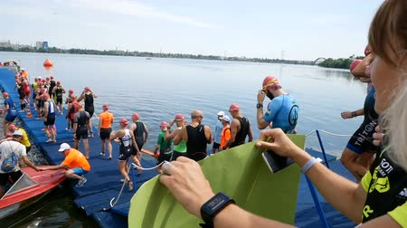 DNIPRO, UKRAINE-June 9, 2019: Dnipro Triathlon Festival, athletes are going to start for competition of swimming, June 9, 2019 in Dnipro, Ukraine Stok Video