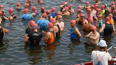 DNIPRO, UKRAINE-June 9, 2019: Dnipro Triathlon Festival, athletes are posing for photo before competition of swimming, June 9, 2019 in Dnipro, Ukraine Stok Video
