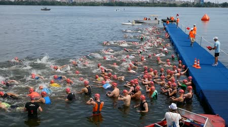 DNIPRO, UKRAINE-June 9, 2019: Dnipro Triathlon Festival, start of swimming competition, June 9, 2019 in Dnipro, Ukraine