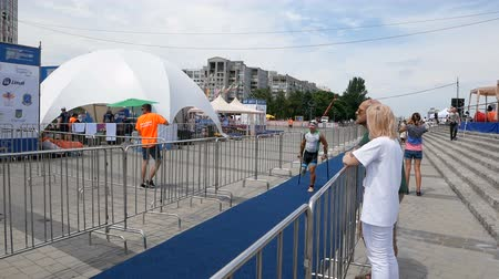 DNIPRO, UKRAINE-June 9, 2019: Dnipro Triathlon Festival, Paralympic athlet on crutches running to cycling competitions, June 9, 2019 in Dnipro, Ukraine Stok Video