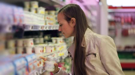 choise : Young woman in supermarket to choosing dairy food yogurt