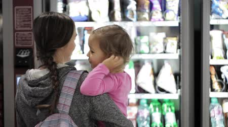 vending machine : Mother and daughter selecting a snacks at vending machine inside airport