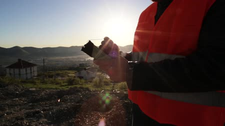 kurmak : Surveyor performing geodesic measurements on top of the mountain