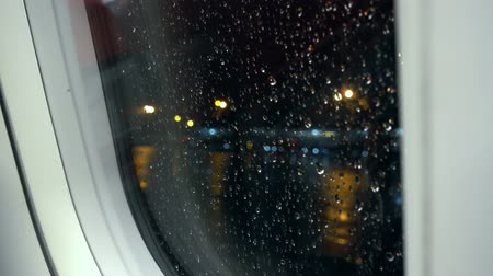 aircraft cabin : View of aircraft window while raining at night