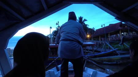 docking : November 2018, Kuching Sarawak : Man rowing a passenger boat docking to jetty