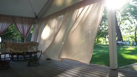 esinti : Curtains slowly blowing back from the wind.