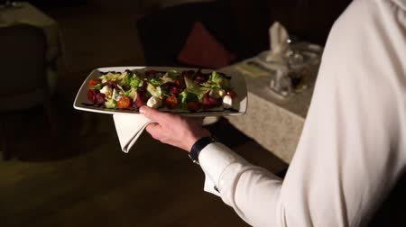 gourmet : The waiter delivers the salad Stock Footage