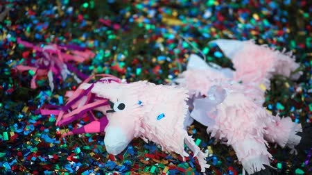 burro : Broken pinata in the form of a horse lying on the grass.
