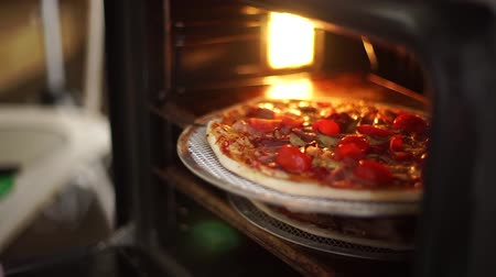 melts : Hot pizza is taken out of the oven.