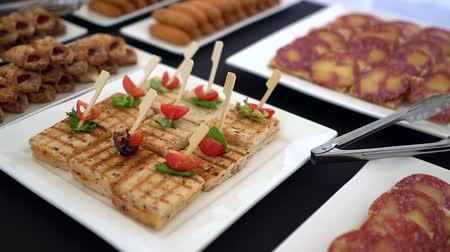 celebration event : Beautifully decorated catering banquet table with sandwich. Stock Footage