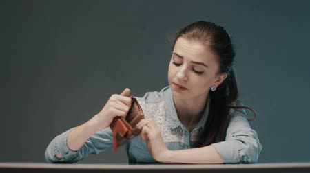 Young woman having financial problems. Money concept.