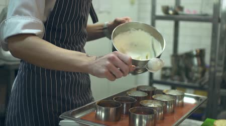 chef : Young cooks making the desserts Stock Footage