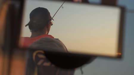 fishermen : a man in a boat caught fisherman has caught a fish. Stock Footage