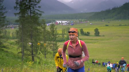 fit : TUNGUR, RUSSIA - 07.2016: Running woman in cross country trail run. Female runner training jogging outdoors in mountain nature landscape on Snaefellsnes, Iceland. Healthy lifestyle fitness model. Stock Footage