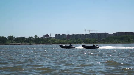 UFARUSSIA - 10.07.2017: Motor boats compete in large water. The spirit of competition and sports victory. Race for the main prize