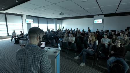 UFA RUSSIA - 04.04.2018: Person says about marketing and management for successful sales to college students indoors closeup. Professional ideas, politics or economy. Energy gesturing in large room. Vídeos