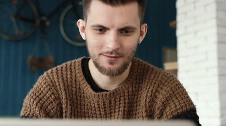 coffee time : Happy man working on laptop in coffee shop Stock Footage