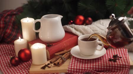 keksz : Hot winter tea in a white mug with  christmas