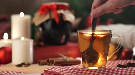 keksz : tea in a white mug with a spoon stir the sugar Christmas with slow  motion Stock mozgókép