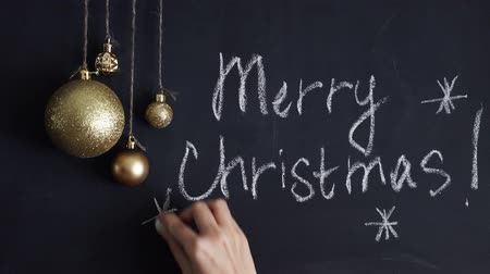 книгопечатание : Elegant greeting card design decorated with snowflakes on chalkboard background for Merry Christmas celebration.