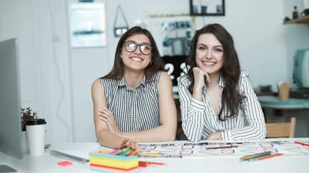 planları : Two women working together at an architect office. look at camera