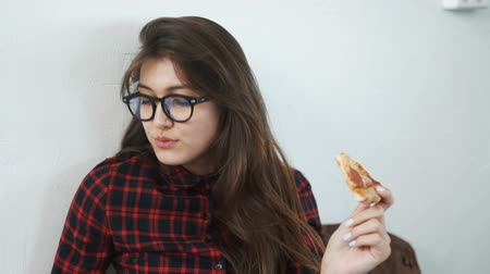 interactive table : woman eating pizza at home