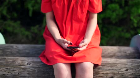 phablet : woman in red dress holding a phone with app mobile wallet Stock Footage
