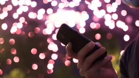 colorful drops : man use smart phone , image of firework as a background.