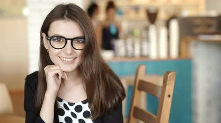 ügyes : education, vision and portrait concept. teenage student girl in glasses at home Stock mozgókép