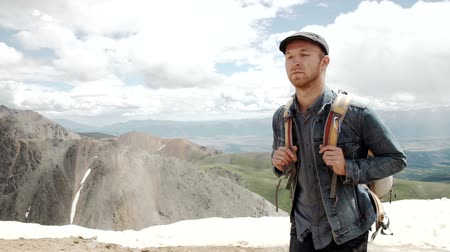inspiradora : Outdoor portrait of Young man hiking on the mountains,smiling happy portrait of tourist male.extreme sport Stock Footage