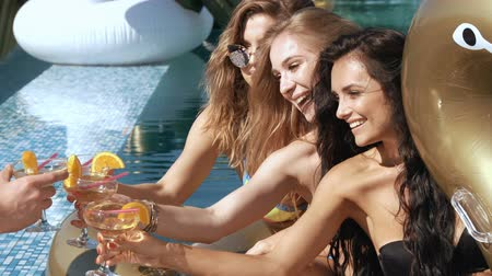 champagne pool : Happy girls with beverages on summer party near the pool. 20s. 1080p Super Slow Motion 240fps.