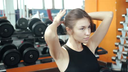 latino americana : Beautiful woman stretching at the gym looking happy 20s. 1080p Slow Motion