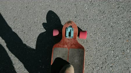 longboarder : Detail of a young man feet riding a skateboard 20s 4k Stock Footage