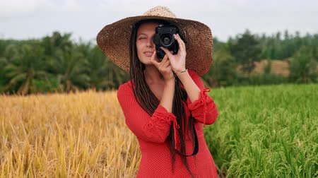 Portrait happy woman taking pictures with vintage camera sunlight travel girl spring beautiful attractive fun photography modern photographing close up tourist vacation fashion cheerful young Vídeos